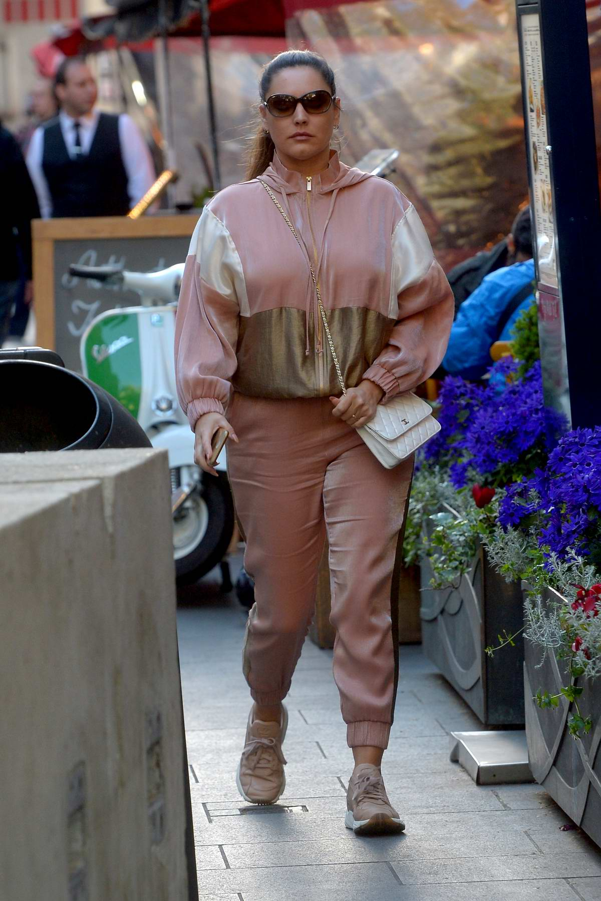 Kelly Brook dons a blush colored tracksuit as she leaves Global Radio Studios In London, UK