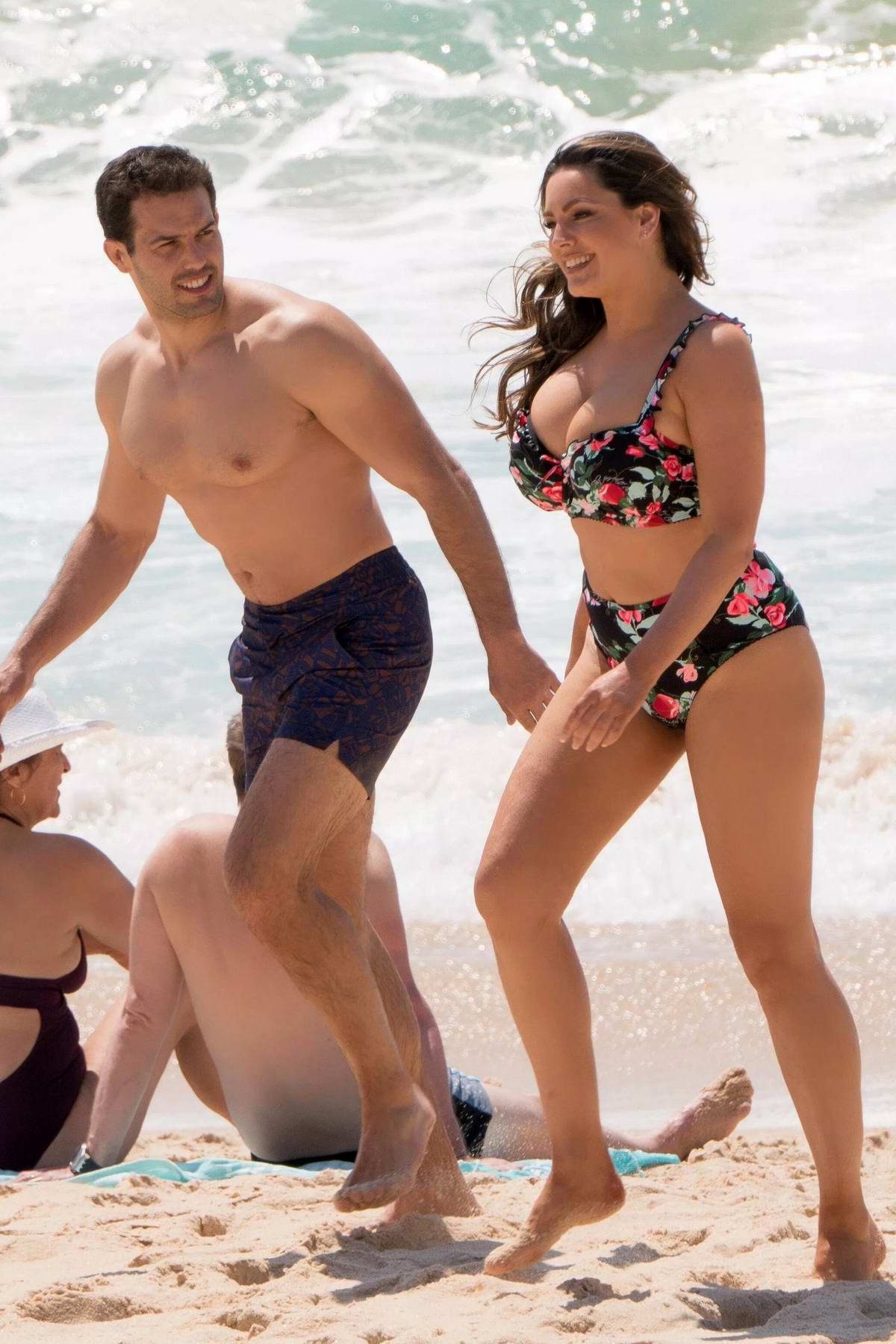 Kelly Brook rocks a floral print bikini as she enjoys a day at the beach with Jeremy Parisi while on holiday in Portugal