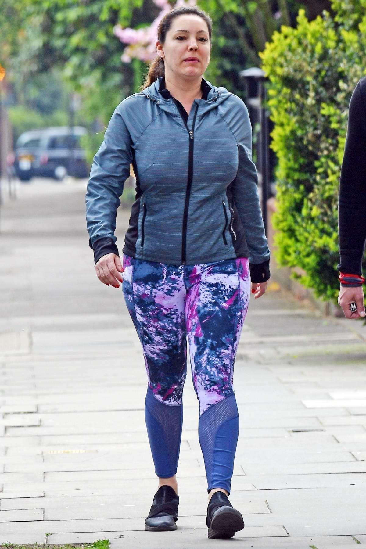 Kelly Brook sports a hoodie and colorful leggings while out for a walk with Jeremy Parisi in London, UK