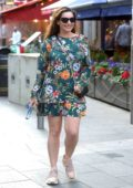 Kelly Brook steps out in a floral print mini dress as she heads to Global Radio Studios in London, UK