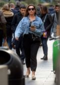 Kelly Brook wears a denim jacket with a black jumpsuit as she heads to Global Radio Studios in London, UK