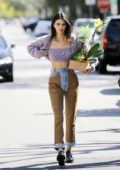 Kendall Jenner enjoys a day out with friends in her lilac-colored classic Cadillac convertible in Los Angeles