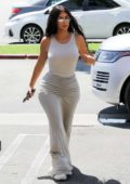 Kim Kardashian dons a form-fitting all grey ensemble as she arrives at Burgerim in Los Angeles