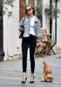 Kimberley Garner looks trendy in a denim jacket and black skinny jeans while out with her dog in Chelsea, London, UK