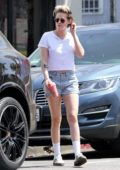 Kristen Stewart rocks a white top and denim shorts for a juice run in Los Angeles