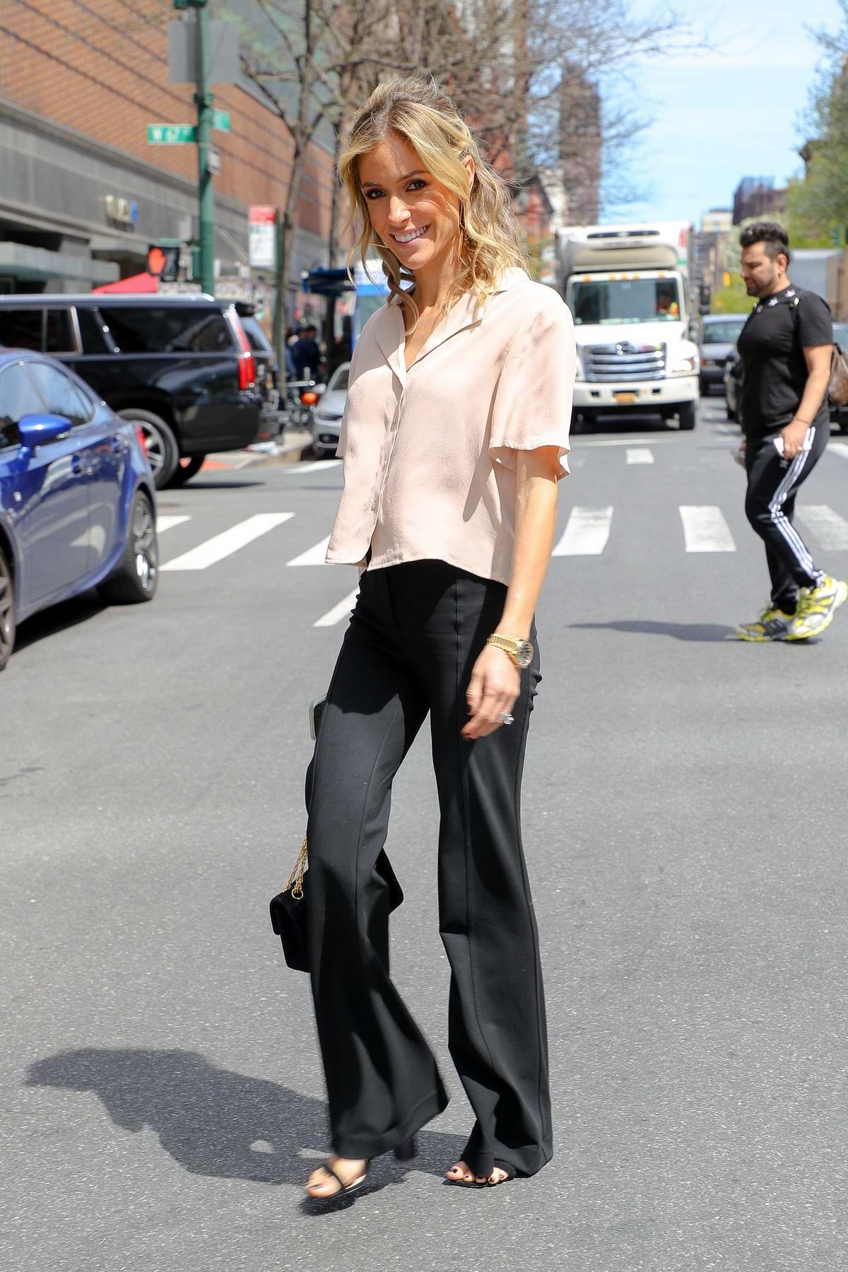 Kristin Cavallari smiles for the camera as she leaves 'On Air with Ryan Seacrest' in New York City
