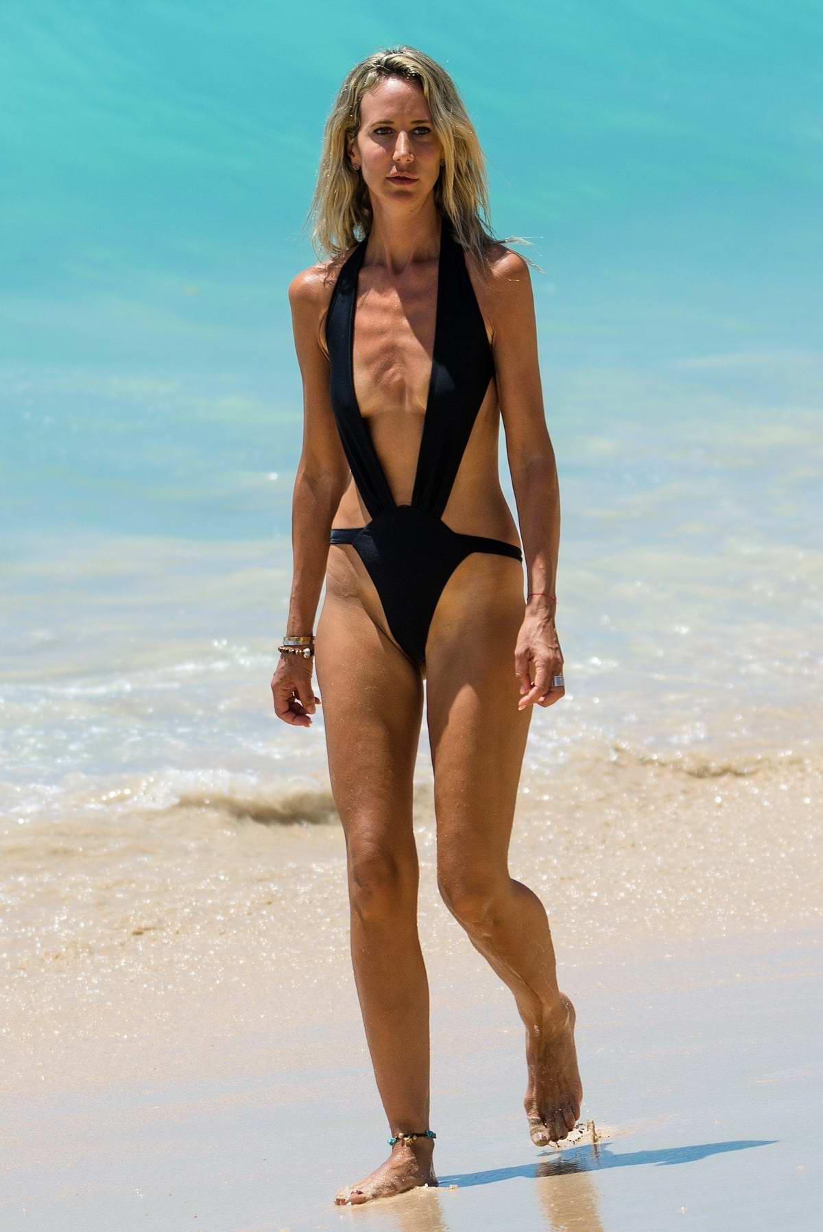 Lady Victoria Hervey rocks a black swimsuit while soaking up the sun at the beach in Barbados