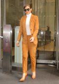 Lauren Cohan looks striking in an orange suit as she leaves an office building in New York City