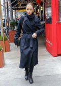 Lily Collins dons all black as she heads to a photoshoot in New York City