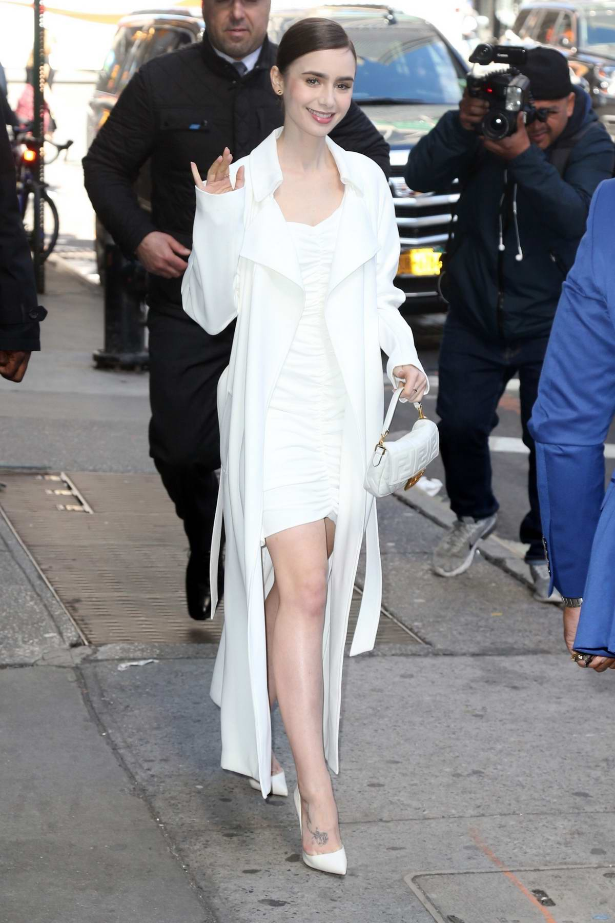 Lily Collins dons an all white ensemble while visiting Good Morning America in New York City