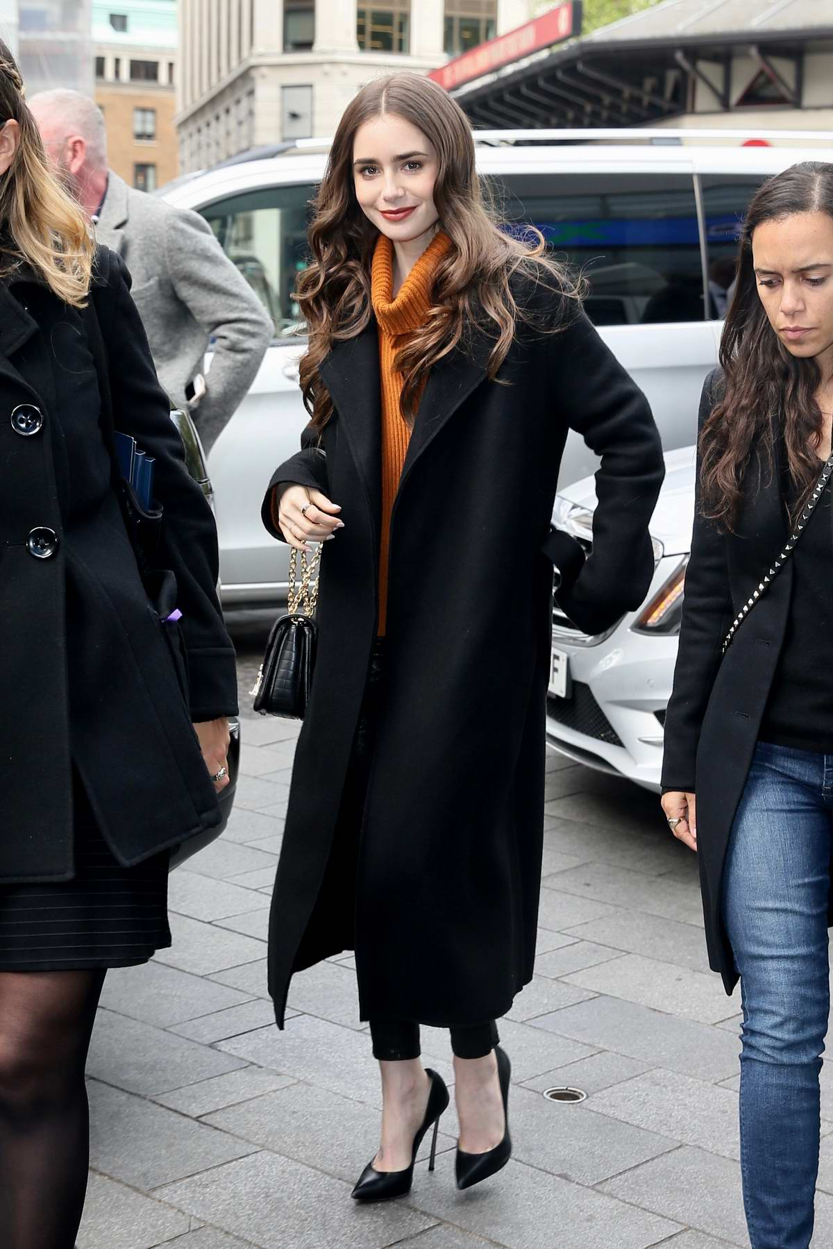 Lily Collins is all smiles as she arrives at Global studios for radio interviews in London, UK