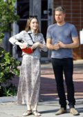 Lily Collins is all smiles while out for a stroll with a friend in West Hollywood, Los Angeles
