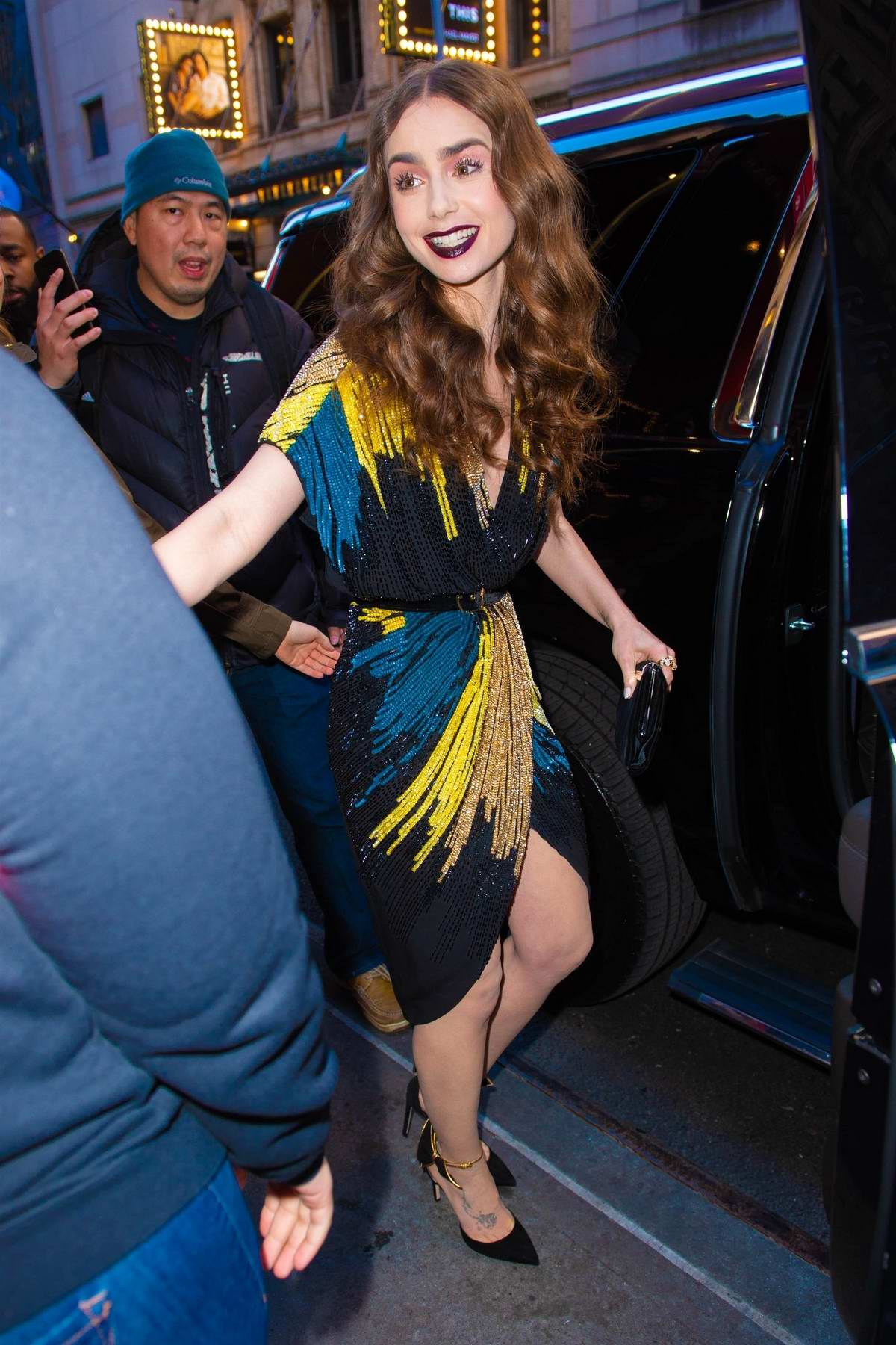 Lily Collins is all smiles while out in a colorful sequined dress in New York City