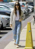 Lily Collins looks casual in an off-white sweater and ripped jeans as she heads for a foot massage in Hollywood, California
