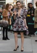 Lily Collins looks cute in a floral mini dress while visiting AOL Build Series in New York City