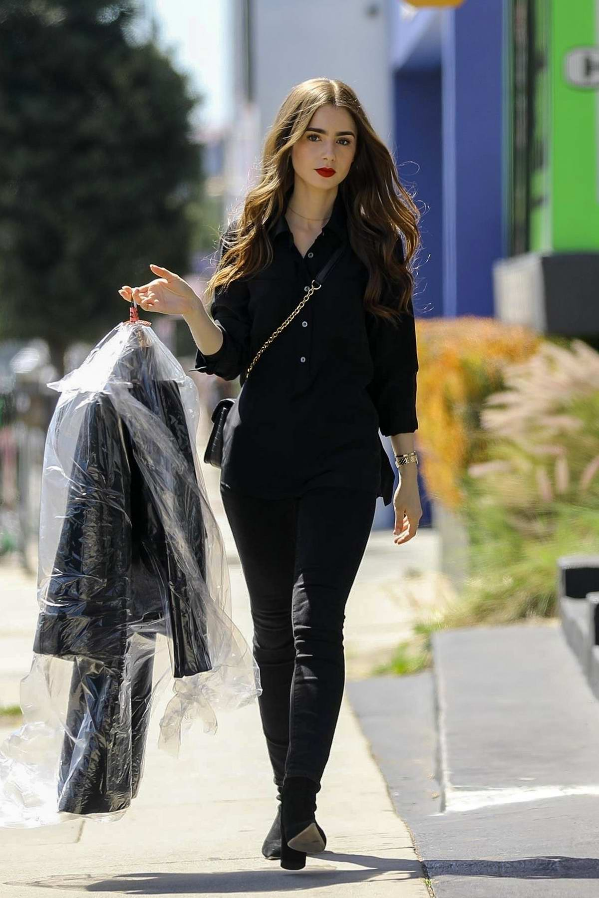 Lily Collins looks radiant in an all black ensemble while out running errands in West Hollywood, Los Angeles