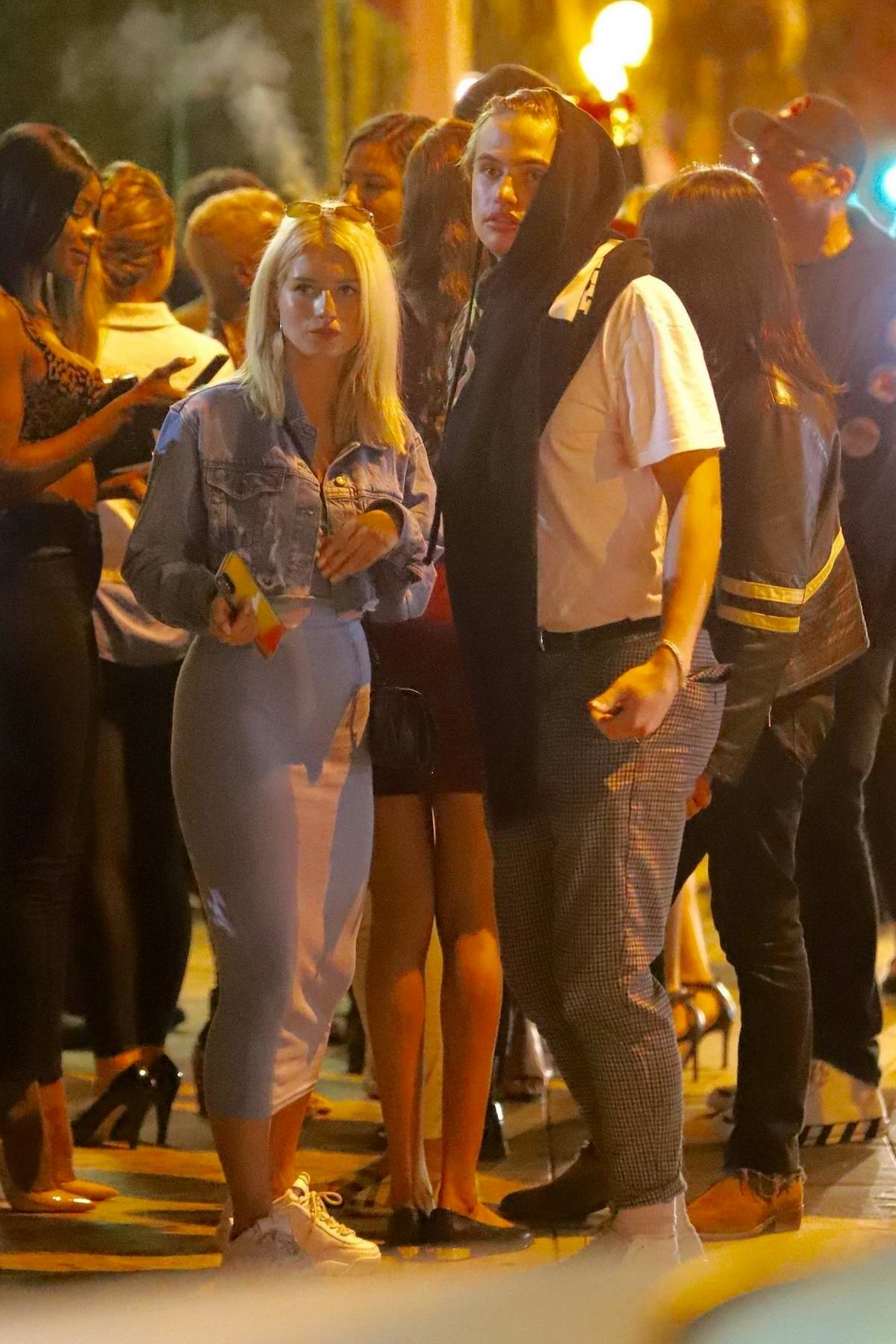 Lottie Moss gets cozy with Daniel Mickelson outside of Delilah nightclub in West Hollywood, Los Angeles