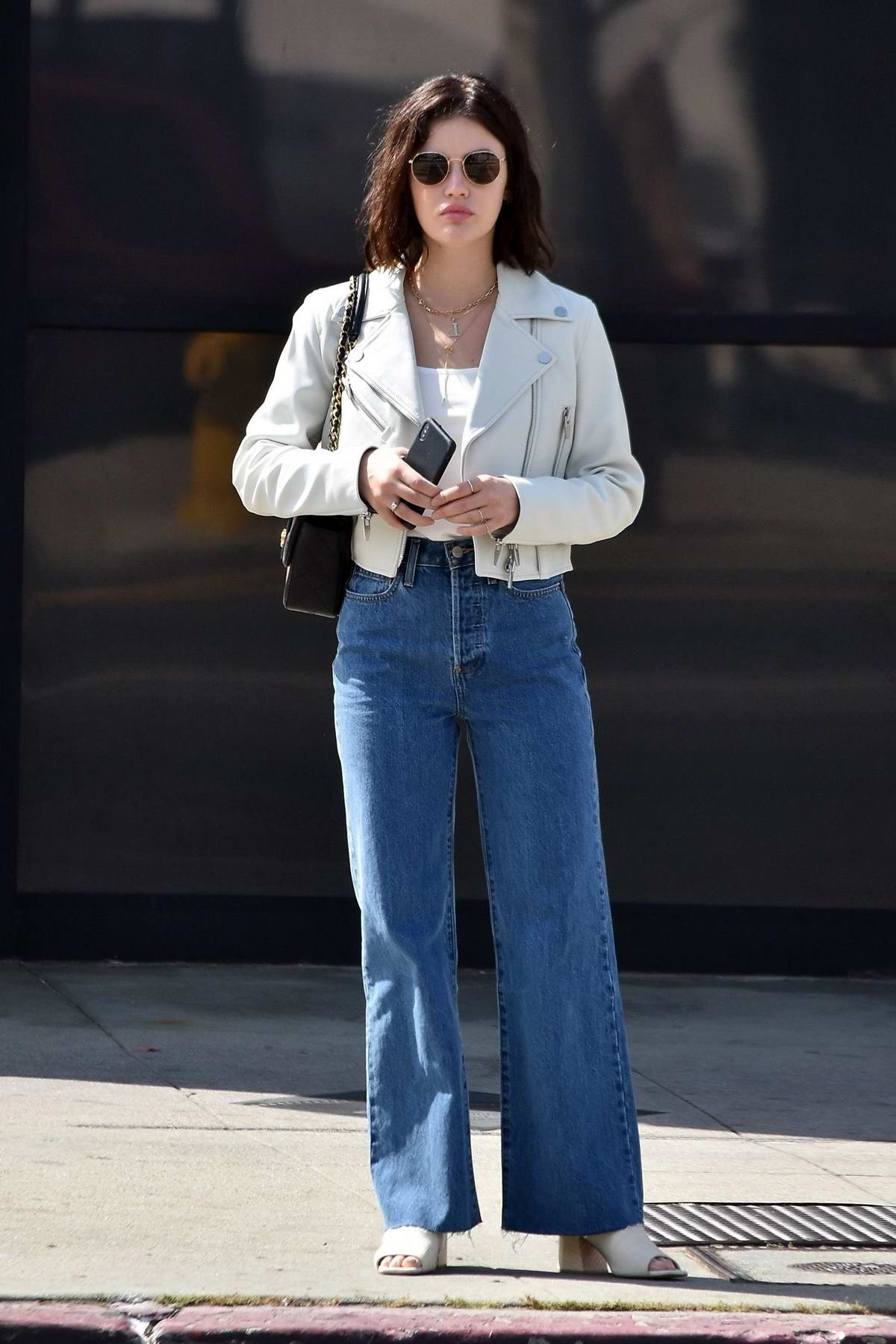 Lucy Hale looks great in a white leather jacket, white top and flared jeans while out on Easter Sunday in Los Angeles