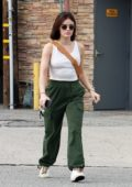 Lucy Hale looks trendy in a white tank top, green cargo pants, and sneaker as she leaves Alfred's coffee in Los Angeles