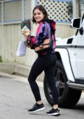 Lucy Hale wears a smile with a colorful tie-dye hoodie and black leggings while out shopping in Studio City, Los Angeles