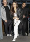Madison Beer dons a black leather jacket with her all white ensemble while visiting NRJ Radio in Paris, France