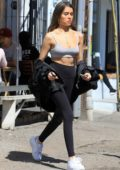 Madison Beer shows off her trim figure in a grey crop top and black leggings during a shopping trip to West Hollywood, Los Angeles