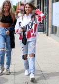 Madison Beer wears a pair of ripped jeans with Canada sweatshirt while out shopping on Melrose Avenue in Los Angeles