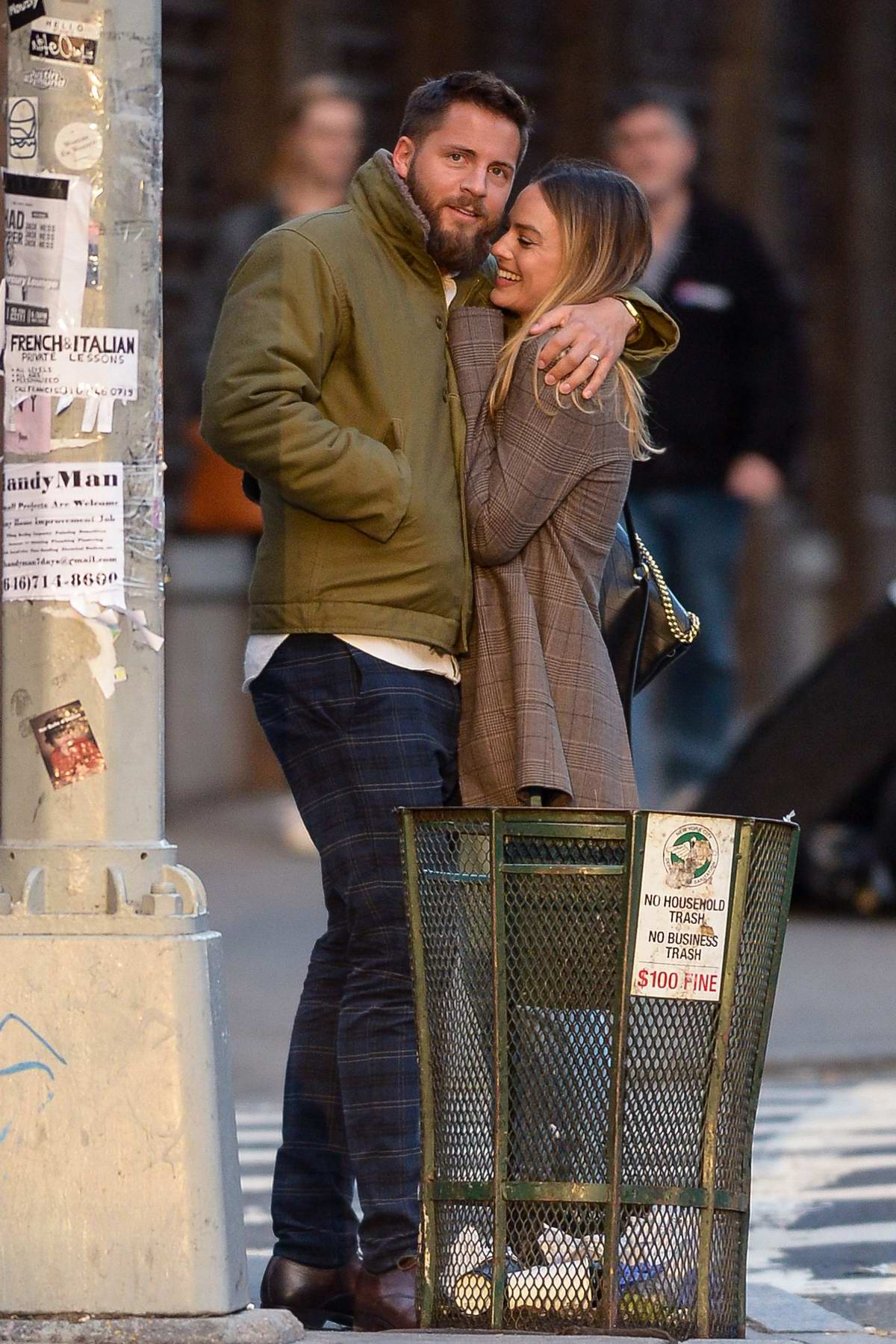 Margot Robbie and Tom Ackerley cuddle up to each other during an outing in New York City