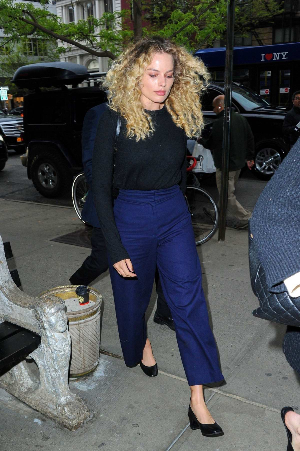 Margot Robbie sports curls while out promoting 'Dreamland' in New York City