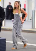 Margot Robbie spotted in a white top and striped overalls as she touches down at JFK airport with Tom Ackerley in New York City