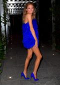Martha Hunt dazzles in a blue feathered mini dress as she heads to celebrate her birthday in New York City