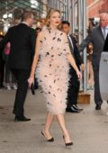 Martha Hunt stuns in a feather dress as she leaves Taylor Swift's apartment to head to 2019 TIME 100 Gala in New York City