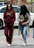 Megan Fox sports burgundy tracksuit while out shopping with friends in Calabasas, California