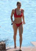 Michelle Hunziker goes for swim wearing a red bikini in Lake Garda, Gargnano, Italy