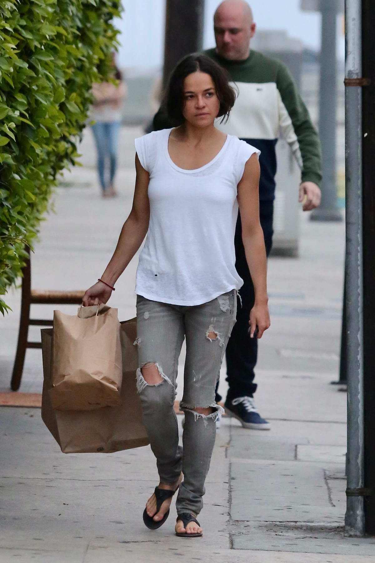 Michelle Rodriguez steps out make-up free for to-go food at Giorgio Baldi in Santa Monica, California