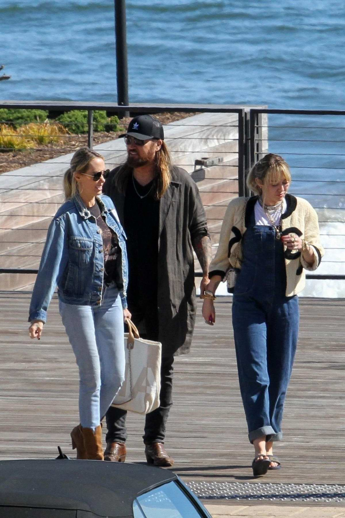 Miley Cyrus and Liam Hemsworth grabs lunch with Billy Ray Cyrus and Tish Cyrus at Nobu in Malibu, California