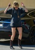 Miley Cyrus rocks a baggy tee with black shorts and cowboy boots while out shopping in Studio City, Los Angeles