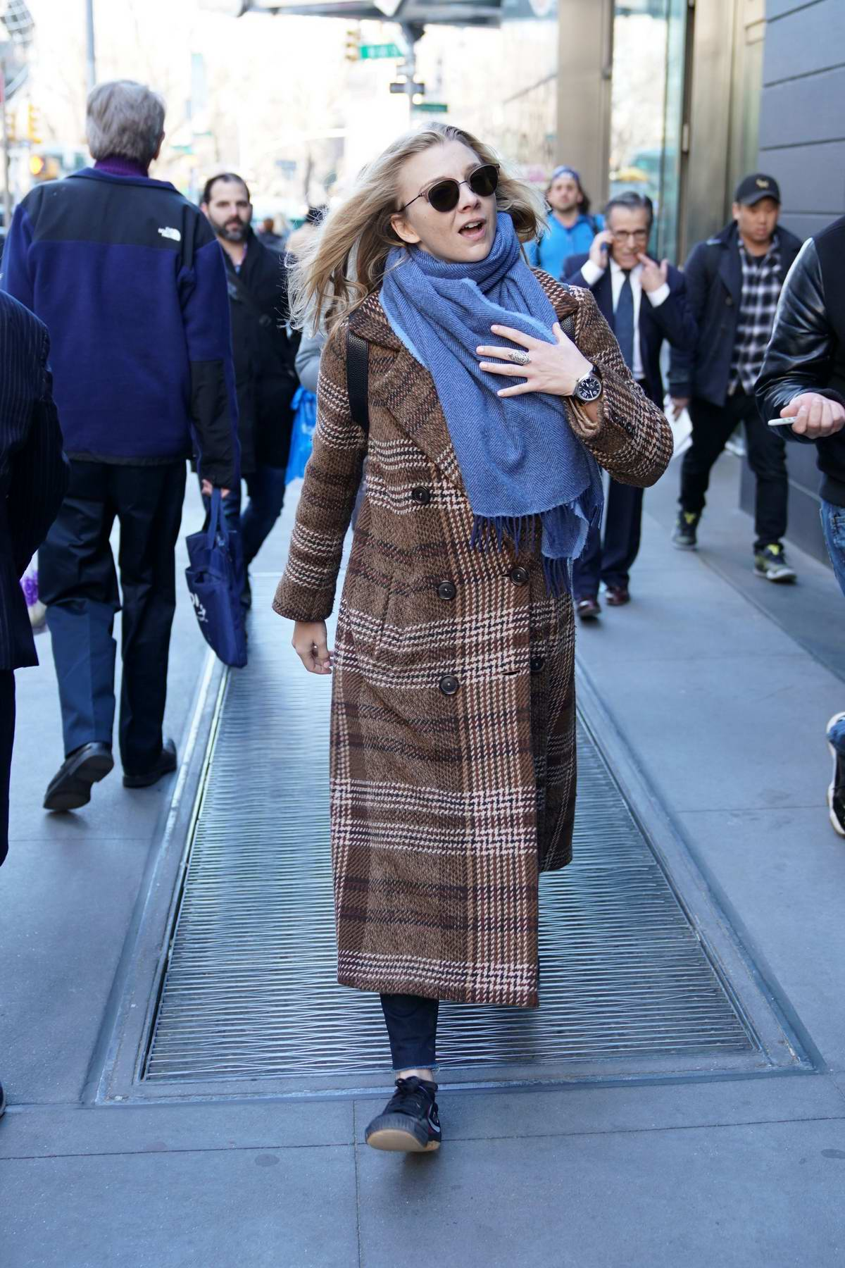 Natalie Dormer bundles up in a plaid long coat and a blue scarf while out and about in New York City