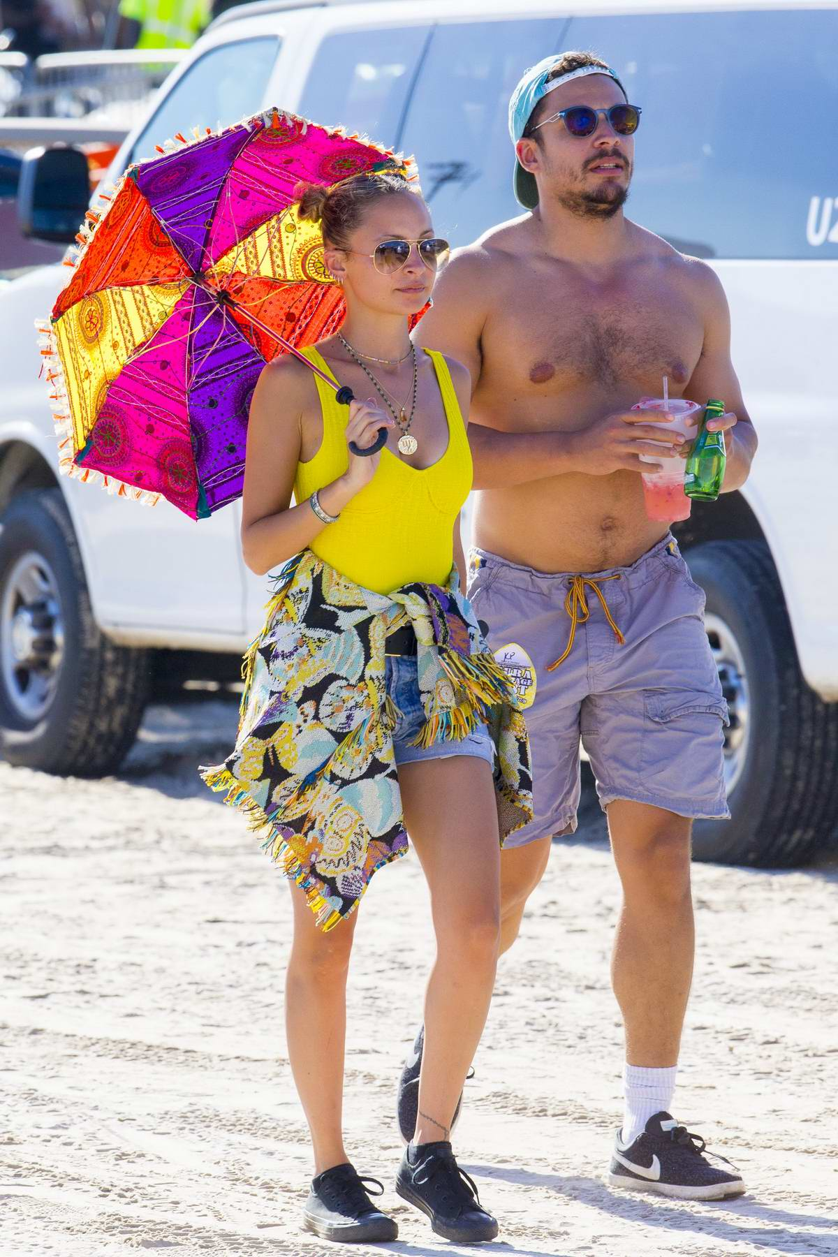 Nicole Richie puts on a colorful display as she enjoys the Jazz and Heritage Festival in New Orleans, Louisiana