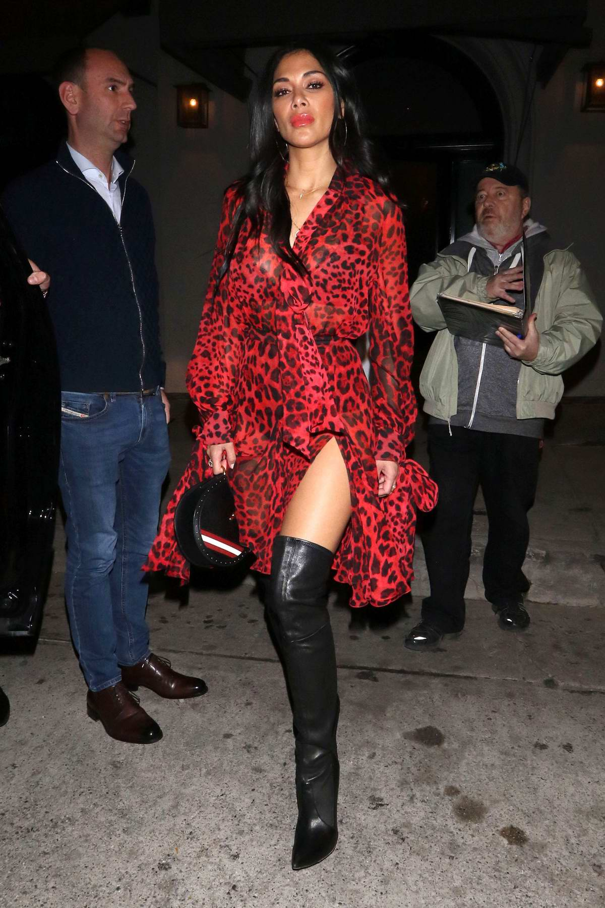 Nicole Scherzinger spotted in a red animal print dress at Craig's in West Hollywood, Los Angeles