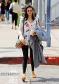 Nina Dobrev wears a floral print top with leggings as she does some shopping after lunch In West Hollywood, Los Angeles