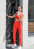 Olivia Culpo flashes her toned body in a red sports bra with matching leggings as she exits a gym in Los Angeles