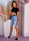 Olivia Culpo looks amazing in a crop tee and cut off jeans at the Revolve Festival during Coachella in Indio, California