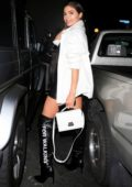 Olivia Culpo looks stylish in a white jacket over black ensemble during a night out with Cara Santana at Delilah in West Hollywood, Los Angeles