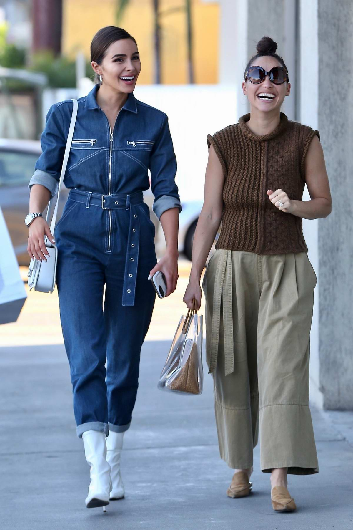 Olivia Culpo sports a denim jumpsuit while visiting a Psychic with Cara Santana in Los Angeles