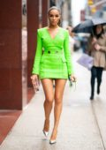 Olivia Culpo stuns in a lime green mini dress as she arrives at Magic Hour Rooftop Bar in New York City