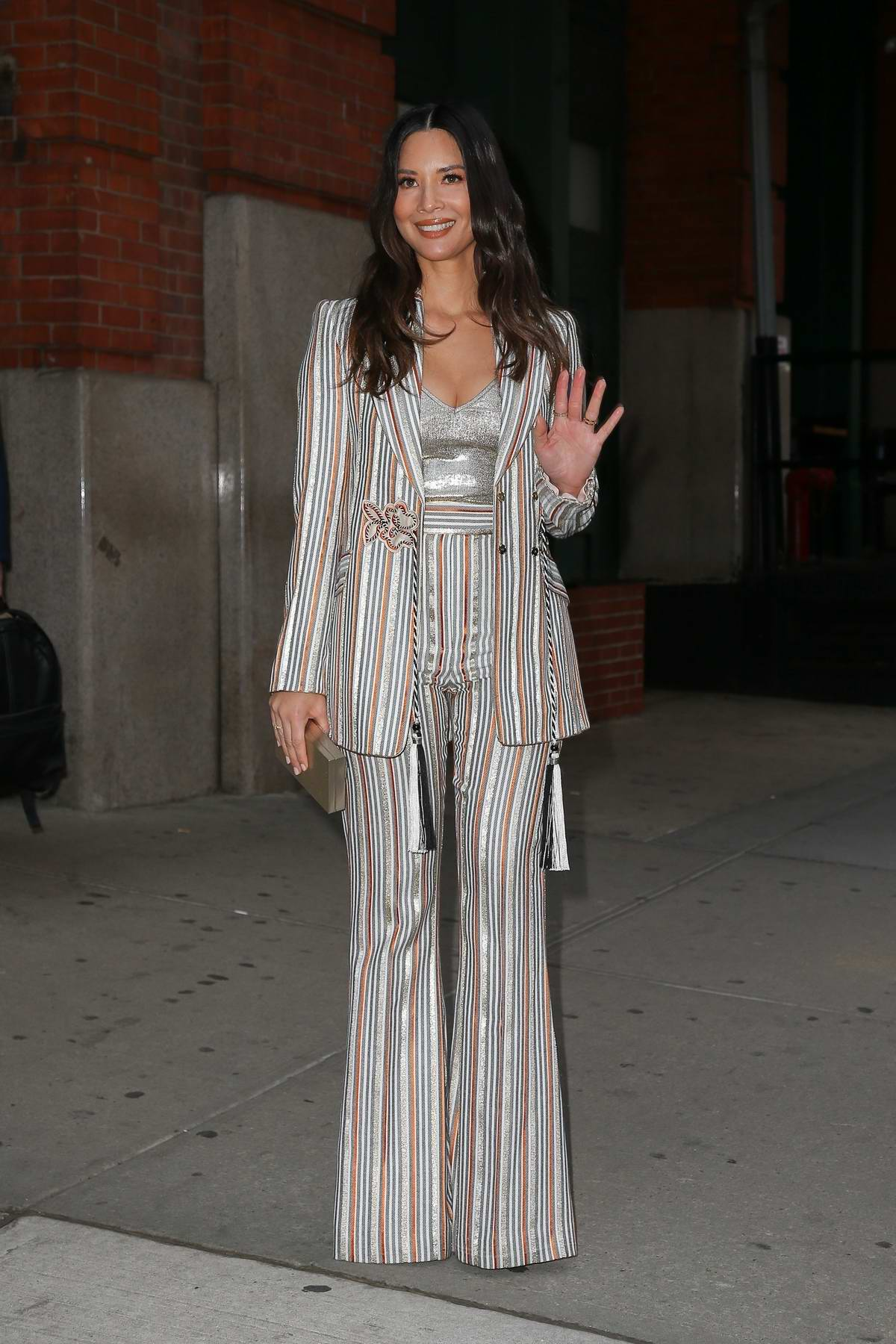 Olivia Munn looks classy with striped silver suit as she leaves The Greenwich Hotel in New York City