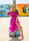 Rachel McCord sizzles in multiple swimsuits during a Voir Eyewear photoshoot on Venice Beach, California