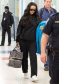 Rihanna arrives at JFK airport wearing all black Balenciaga in New York City