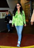 Rihanna stands out in a bright green shirt as she leaves a photoshoot in New York City